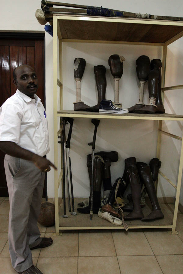 Suresh shows us a selection of prosthetic legs at the Physical Rehabilitation Reference Centre in Juba, South Sudan