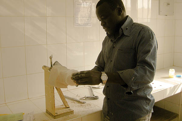A technician grinds away at a plaster leg cast at the Physical Rehabilitation Reference Centre in Juba, South Sudan