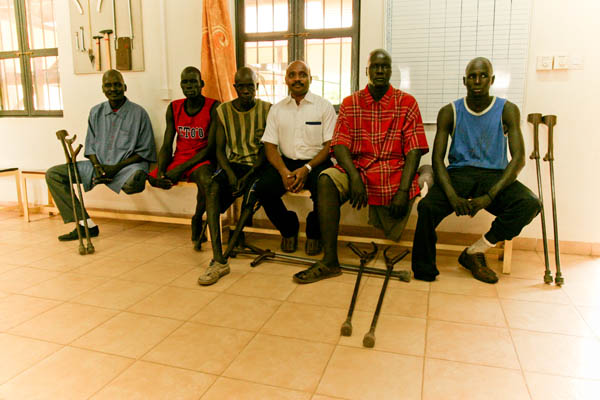 Five South Sudanese men with Suresh during their gait training at the Physical Rehabilitation Reference Centre in Juba, South Sudan