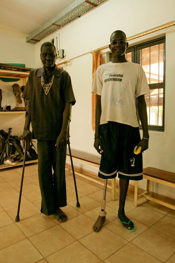 Two South Sudanese men, proud of their increasing mobility at the Physical Rehabilitation Reference Centre in Juba, South Sudan