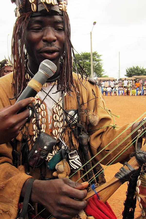 Dozo singer with charms in Daloa, Côte d'Ivoire