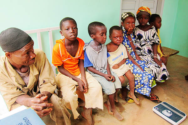 A father and some patients wait for their measles treatment