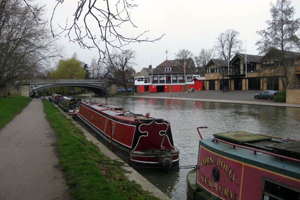 Narrowboats and rowing clubs on the River Cam in Cambridge, England