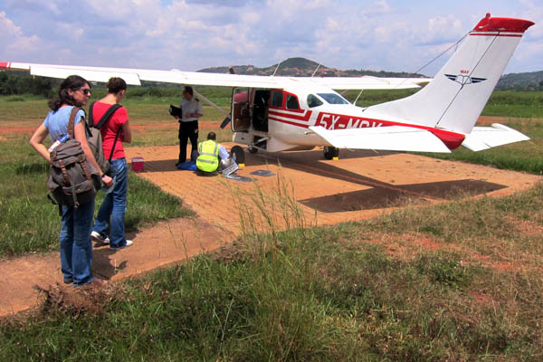 Preparing to board a Cessna 206 at Kajjansi Airfield, Uganda