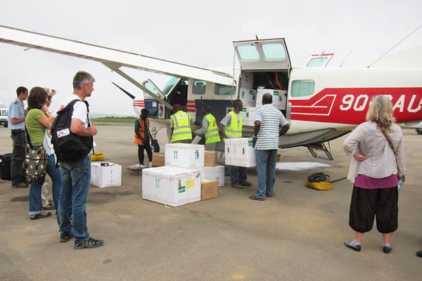 Loading cargo on a Cessna 208 Caravan I at Bunia Murongo Airport