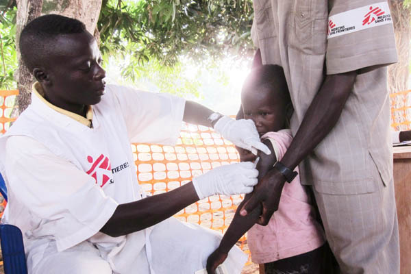 Child being vaccinated against measles, Faradje