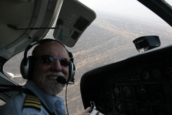 John, pilot extraordinaire, banking left to see some elephants