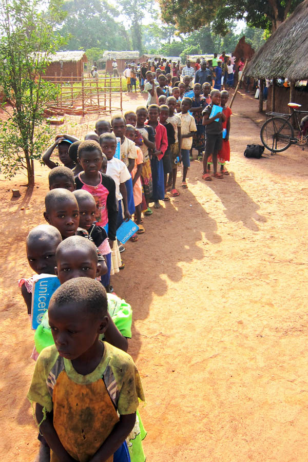 Children waiting to be vaccinated in Kpekpere, DR Congo