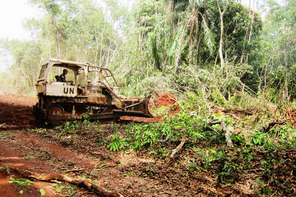Indonesian military bulldozer preparing the Dungu-Duru road