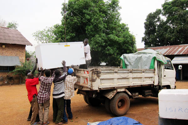 Loading an MF314 freezer onto a truck in Dungu, DR Congo