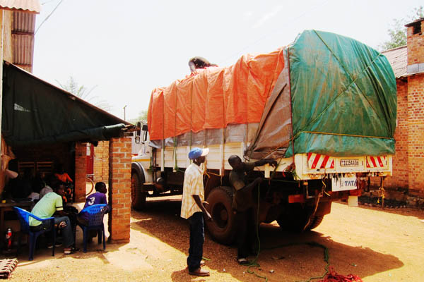 Tying down the tarps on a truck in Dungu, DR Congo