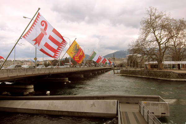 Flags of all the Swiss cantons on a bridge in Geneva