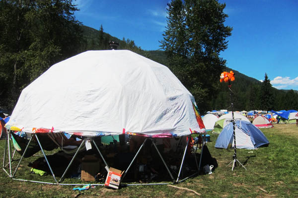Our geodesic dome, with Tyvek cover rolled partway up, and Tigger totem