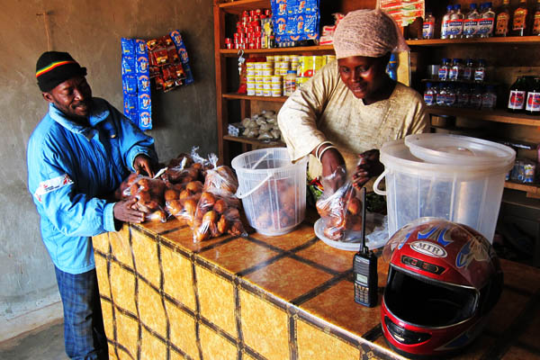 Buying donuts in Faradje, DRC