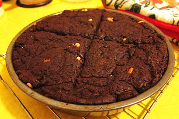 Four huge brownies with walnuts