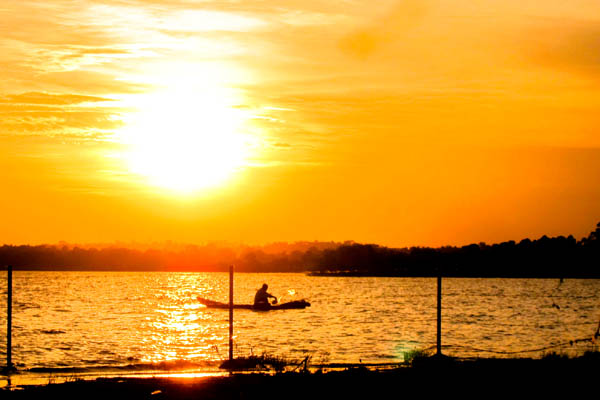 Fisherman at sunset on Lake Victoria, Uganda