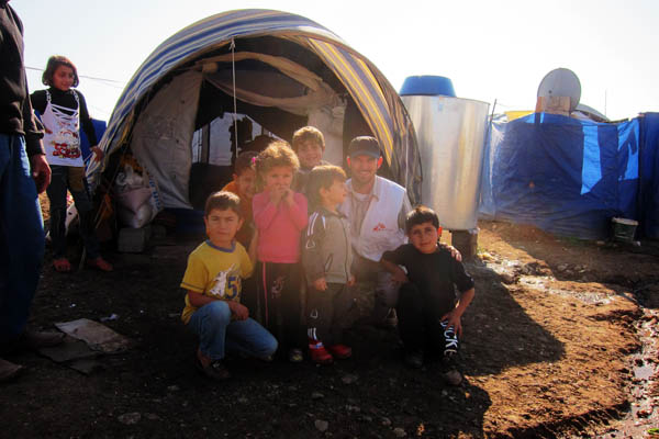 With refugee children in Domiz Refugee Camp for Syrians, Iraq