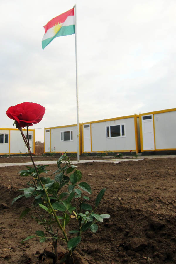 Preschool in Domiz Refugee Camp for Syrians, Iraq with Kurdistan flag