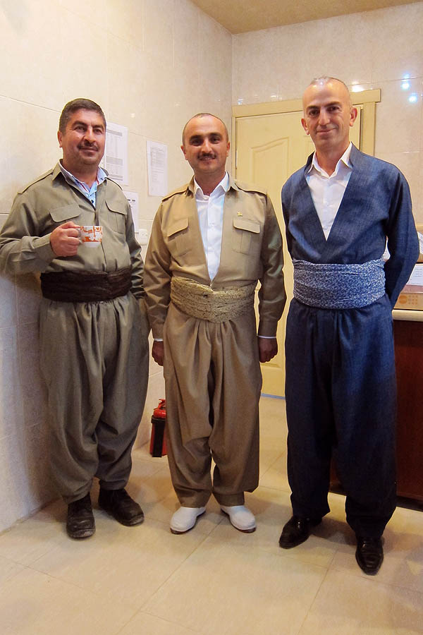 Salih, Ziyad, and Dilovan in traditional Kurdish dress
