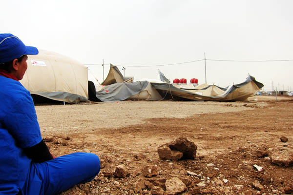 Nahla rues the health centre tents destroyed by a storm