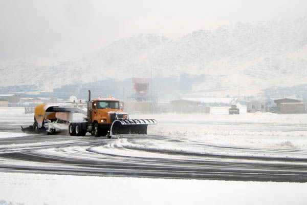 Snowplow clearing the runways of Kabul International Airport