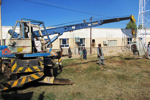 A crane moves an old autoclave at Bost Provincial Hospital, Afghanistan