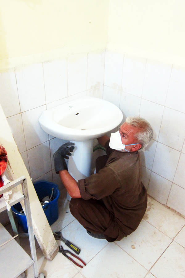 Installing a new handwashing sink in the female burns unit of Bost Provincial Hospital, Lashkar Gah