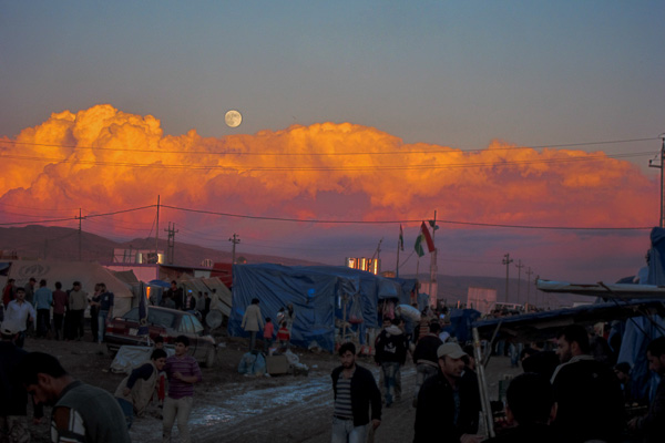 Moonrise on a muddy evening near the main entrance to Domiz Refugee Camp, Duhok, Iraq