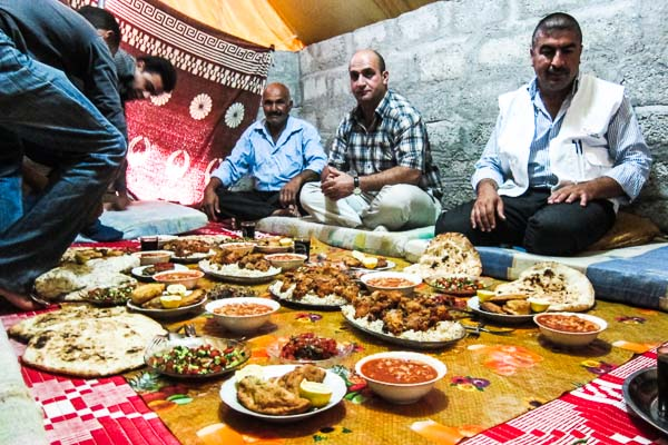 Sitting down to lunch in Domiz Refugee Camp, Duhok, Iraq