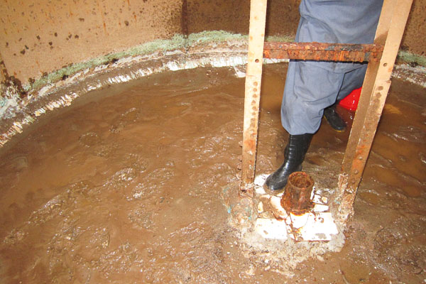 Sediment on floor of 45 cubic metre water reservoir