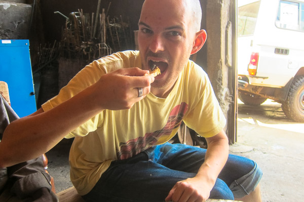 Eating caterpillars with baguette in Bangui, CAR