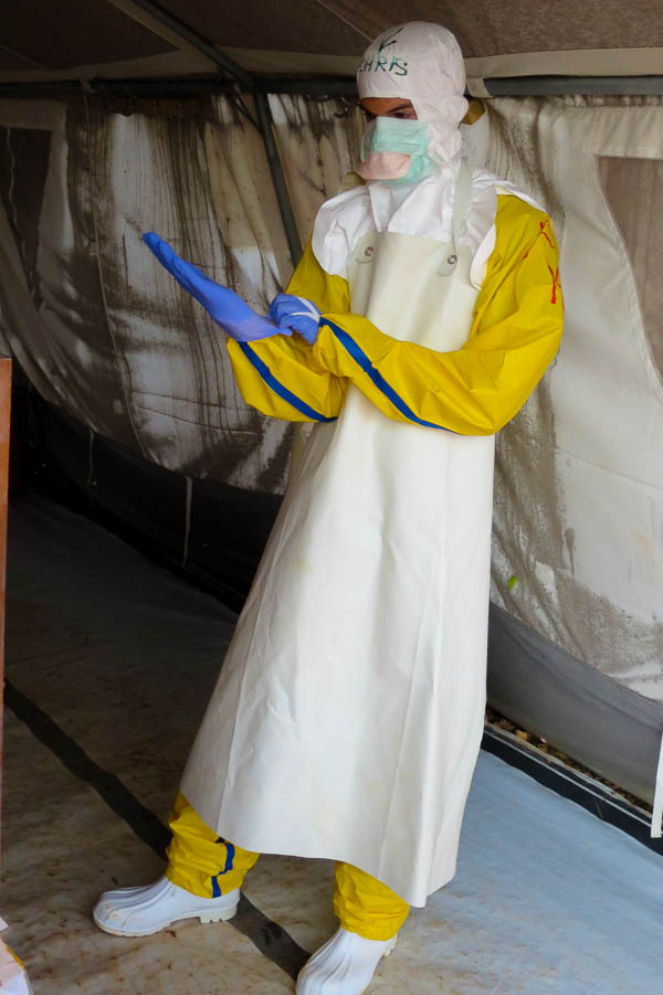 Dressing up in full personal protective equipment (PPE) in Kailahun, Sierra Leone