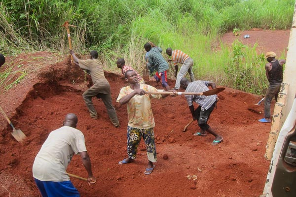 Daily workers digging laterite soil outside Grimari, Central African Republic