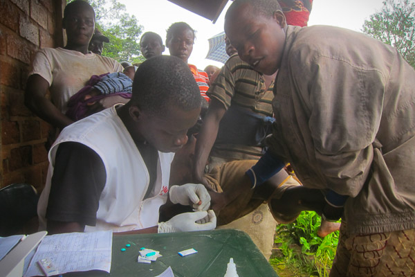 Brice testing locals for Malaria in Yamalé