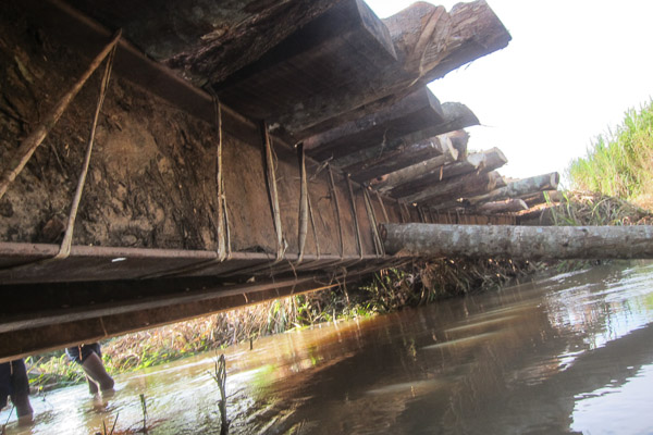 Timbers and logs lashed onto metal bridge beams at Pont Bongou, Central African Republic