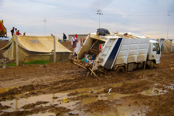 Garbage truck stuck in the mud in Domiz Refugee Camp, November 2012