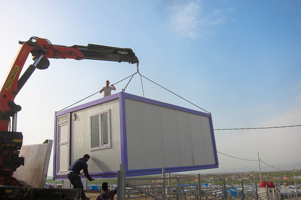 Lowering the prefabricated malnutrition building into place