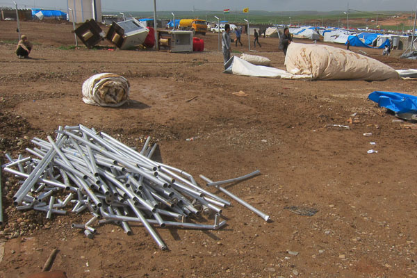 Cleaning up after the storm at the primary health centre, Domiz Refugee Camp, March 2013