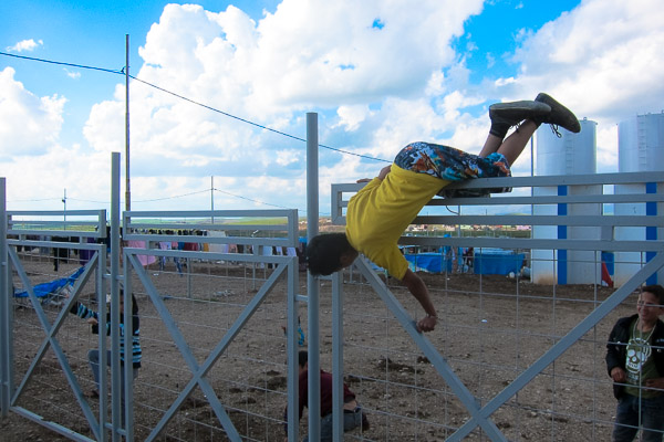A Syrian refugee boy performs a gate vault, a move frequently used by traceurs in Parkour