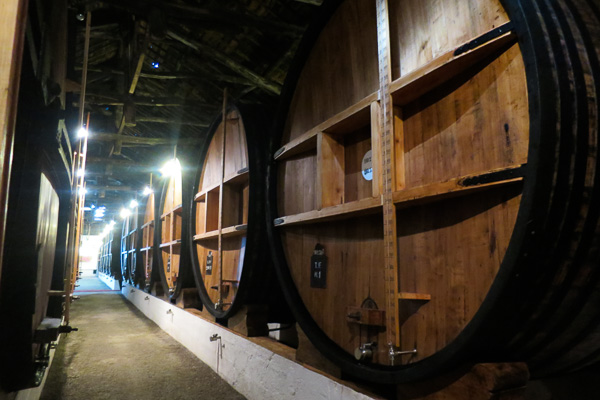 Enormous barrels of Taylor's port ageing in the cellars at Porto