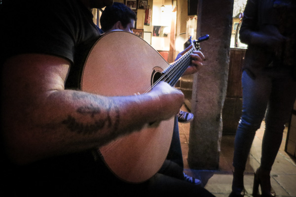 Twelve-string Portuguese guitar during a fado performance in Lisbon, Portugal