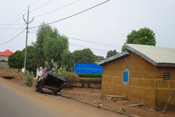 Flipped car in the outskirts of Kankan, Guinea