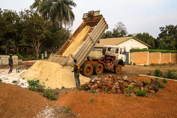 Sand delivery for construction at the Red Cross Ebola operational base in Coyah, Guinea