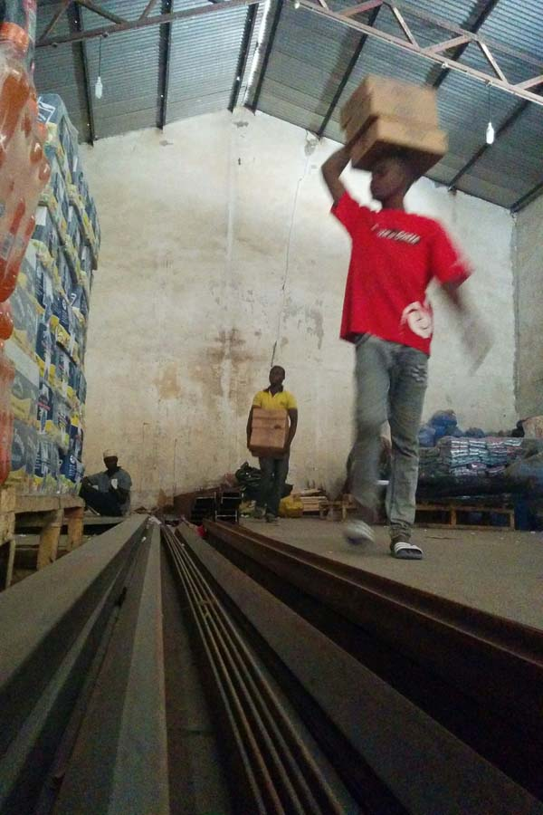 Clearing space in the big warehouse, to build a medical storeroom in Maiduguri, Borno State, Nigeria