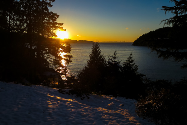 Sunrise over West Vancouver and the snow-covered lawn at Bowen Island
