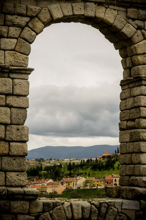 Looking through an archway in the Roman aqueduct in Segovia