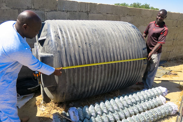 Measuring water tanks for a camp distribution system, Monguno, Borno State, Nigeria